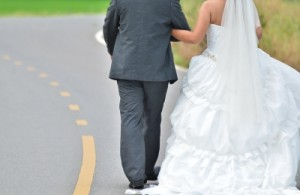 """Bride And Groom Walking Away On The Road"" by Just2shutter"